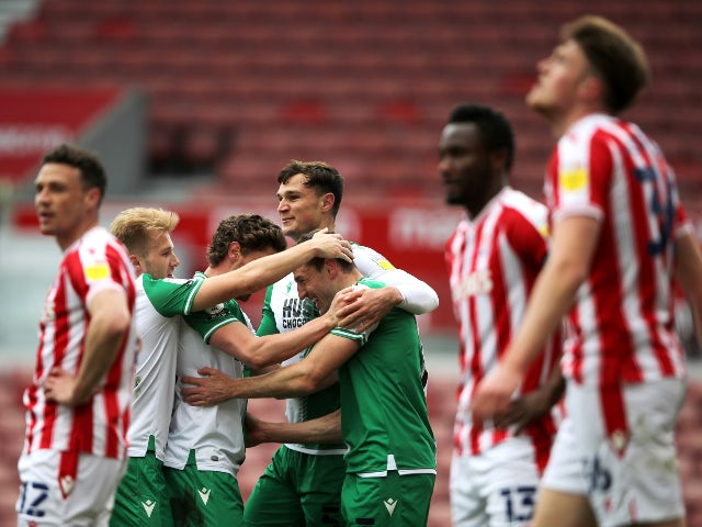 Millwall's Murray Wallace celebrates with teammates after scoring their first goal against Stoke City in the Championship on April 5, 2021