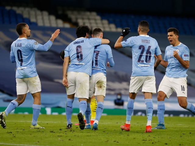 Manchester City's Phil Foden celebrates scoring their second goal against Borussia Dortmund in the Champions League on April 6, 2021