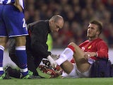 Manchester United's David Beckham receives treatment after an injury in 2002