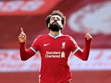 Liverpool's Mohamed Salah celebrates scoring their first goal against Aston Villa on April 10, 2021