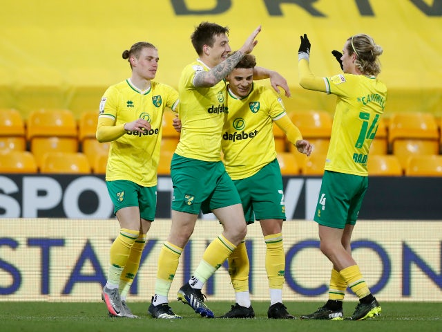 Norwich City's Jordan Hugill celebrates scoring their seventh goal against Huddersfield Town in the Championship on April 6, 2021