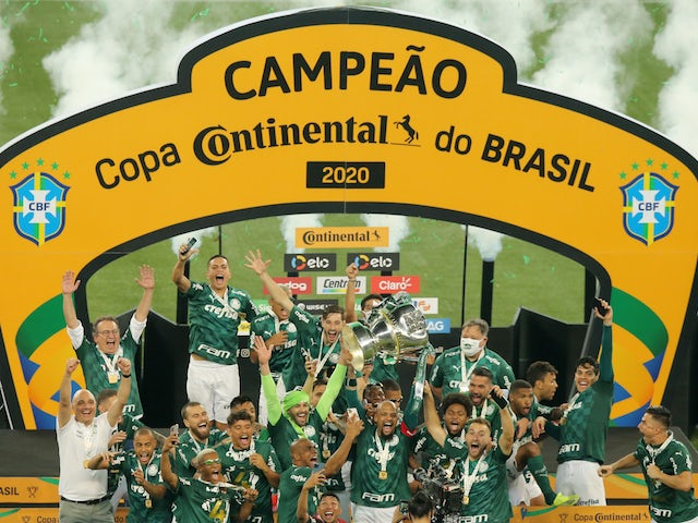 Palmeiras' Felipe Melo and teammates celebrate with the trophy after winning the Copa do Brasil on March 7, 2021