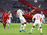 Bayern Munich's Thomas Muller shoots at goal with an overhead kick against Paris Saint-Germain on April 7, 2021