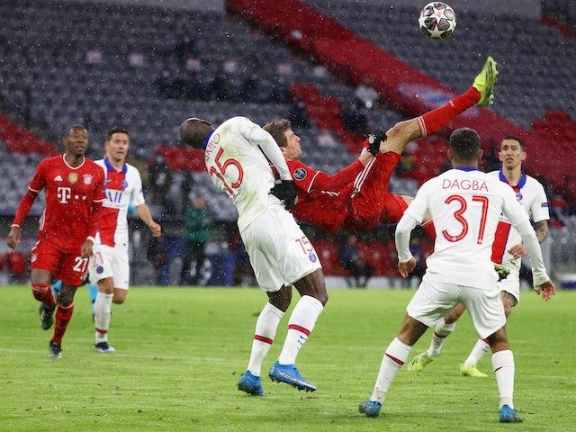 Bayern Munich's Thomas Muller shoots at goal with an overhead kick against Paris Saint-Germain on April 7, 2021