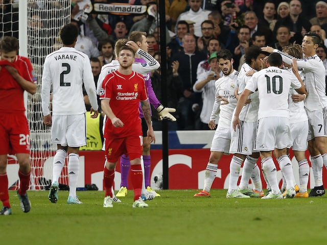 Real Madrid's players celebrate a goal against Liverpool during their Champions League Group B soccer match at Santiago Bernabeu stadium in Madrid November 4, 2014