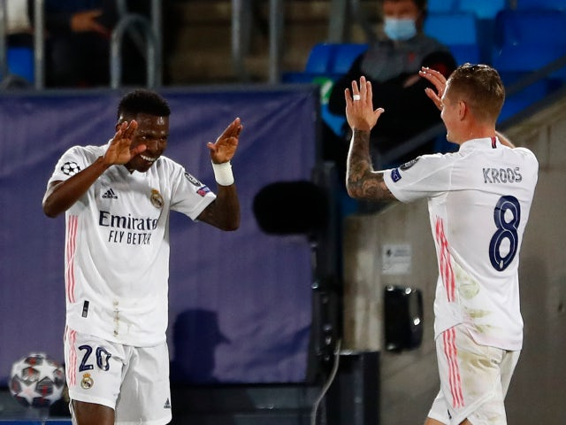Real Madrid's Vinicius Junior celebrates scoring their first goal with Toni Kroos against Liverpool in the Champions League on April 6, 2021