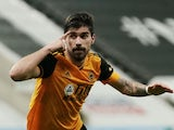 Ruben Neves celebrates scoring for Wolves on February 27, 2021