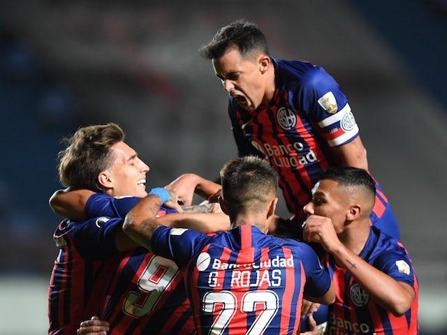 San Lorenzo's Franco Di Santo celebrates scoring their first goal with teammates on March 17, 2021
