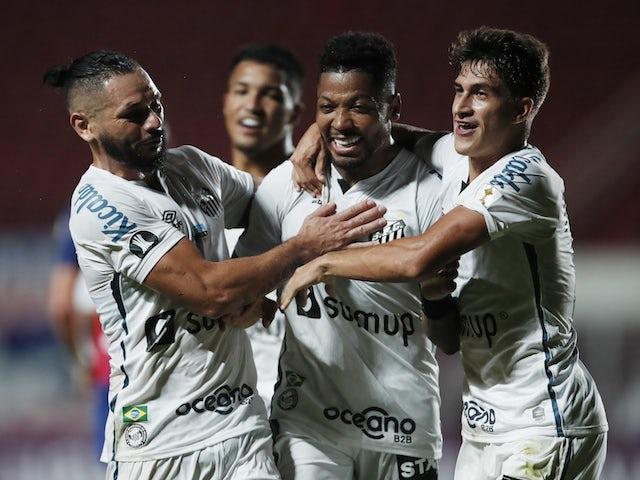 Santos' Marinho celebrates scoring their second goal with teammates on april 7, 2021