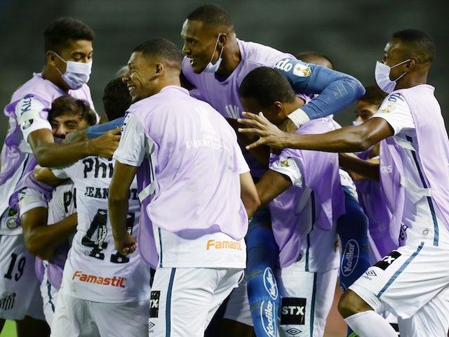 Santos' Yeferson Soteldo celebrates scoring their first goal with teammates opn March 16, 2021