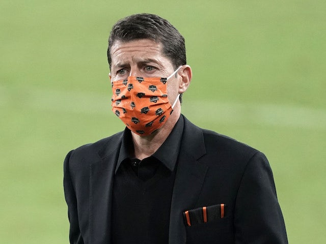 Houston Dynamo coach Tab Ramos wears a face mask during a game against the LAFC at Banc of California Stadium in October 2020