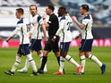 Tottenham Hotspur players surround the referee against Manchester United in the Premier League on April 11, 2021