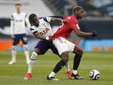 Manchester United's Paul Pogba in action with Tottenham Hotspur's Serge Aurier in the Premier League on April 11, 2021