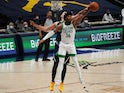 Boston Celtics guard Marcus Smart grabs a rebound away from Denver Nuggets center Nikola Jokic on April 11, 2021