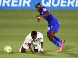 Real Madrid's Vinicius Junior in action with Getafe's Allan Nyom in La Liga on April 18, 2021