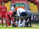 Aston Villa's Trezeguet goes down injured against Liverpool in the Premier League on April 10, 2021