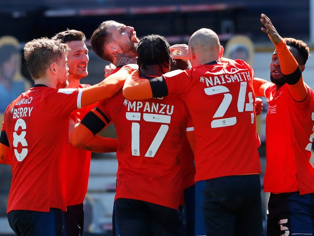 Luton Town's James Collins celebrates scoring their first goal against Watford in the Championship on April 17, 2021