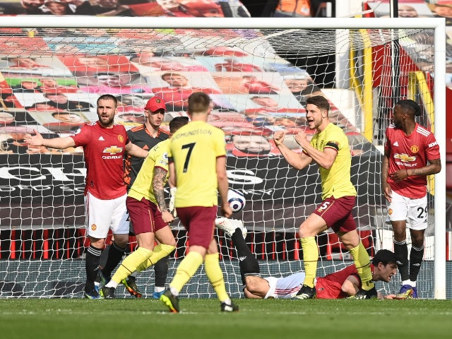 Burnley's James Tarkowski celebrates scoring their first goal against Manchester United in the Premier League on April 18, 2021