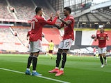 Manchester United's Mason Greenwood celebrates scoring their first goal with Marcus Rashford  against Burnley in the Premier League on April 18, 2021