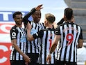 Newcastle United's Joe Willock celebrates scoring against West Ham United in the Premier League on April 17, 2021