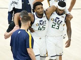 Utah Jazz guard Donovan Mitchell is helped off the court after suffering an injury against the Indiana Pacers on April 17, 2021