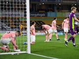 Sheffield United's Enda Stevens and teammates look dejected after Wolverhampton Wanderers' Willian Jose scored their first goal in the Premier League on April 17, 2021