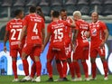 America de Cali's Edwin Velasco celebrates their first goal with Duvan Vergara and teammates in October 2020