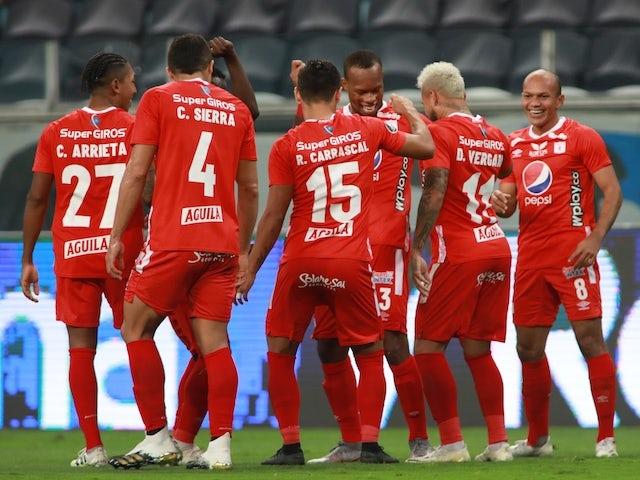 America de Cali's Edwin Velasco celebrates their first goal with Duvan Vergara and teammates in October 2020