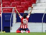 Atletico Madrid's Angel Correa celebrates scoring against Huesca on April 22, 2021