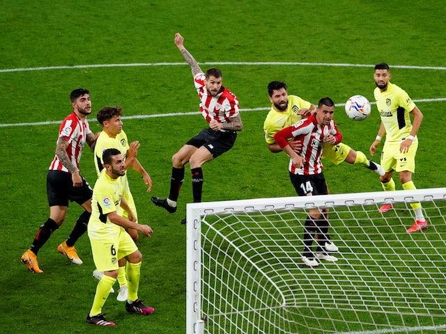 Athletic Bilbao's Inigo Martinez scores against Atletico Madrid in La Liga on April 25, 2021