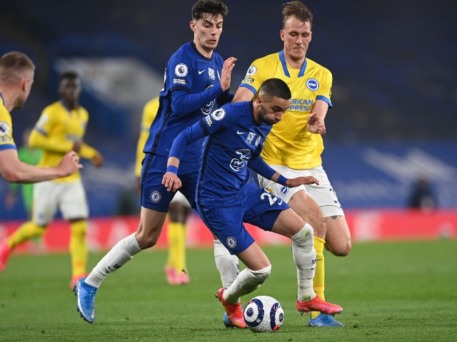 Chelsea's Hakim Ziyech and Kai Havertz in action with Brighton & Hove Albion's Dan Burn in the Premier League on April 20, 2021