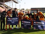 Hull City celebrate promotion to the Championship on April 24, 2021