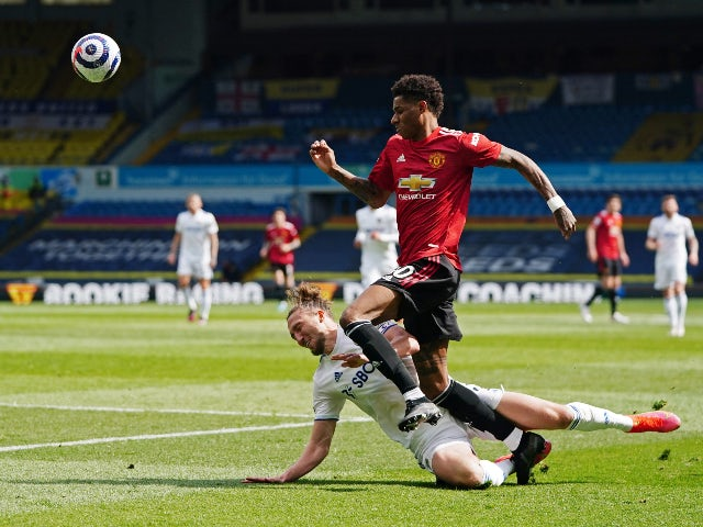 Manchester United's Marcus Rashford in action with Leeds United's Luke Ayling in the Premier League on April 25, 2021