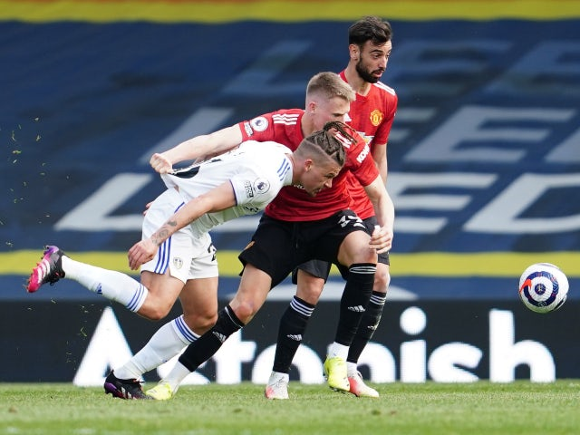 Leeds United's Kalvin Phillips in action with Manchester United's Scott McTominay in the Premier League on April 25, 2021