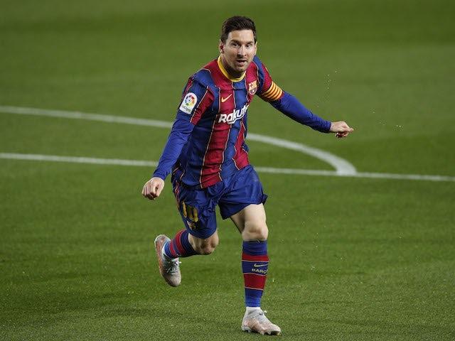 Barcelona's Lionel Messi celebrates scoring against Getafe in La Liga on April 22, 2021
