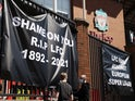 Anti Super League banners and Liverpool fans are seen outside Anfield as twelve of Europe's top football clubs launch a breakaway Super League