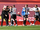 Newcastle United's Joe Willock celebrates scoring their first goal against Liverpool in the Premier League on April 24, 2021