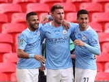 Manchester City's Aymeric Laporte celebrates scoring against Tottenham Hotspur in the EFL Cup final on April 25, 2021