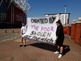 Manchester United fans hold an anti Super League banner outside Old Trafford as twelve of Europe's top football clubs launch a breakaway Super League