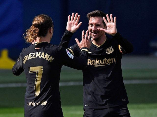 Barcelona's Antoine Griezmann celebrates scoring against Villarreal with Lionel Messi on April 25, 2021