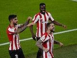 Athletic Bilbao's Inigo Martinez celebrates scoring their second goal with teammates on April 25, 2021