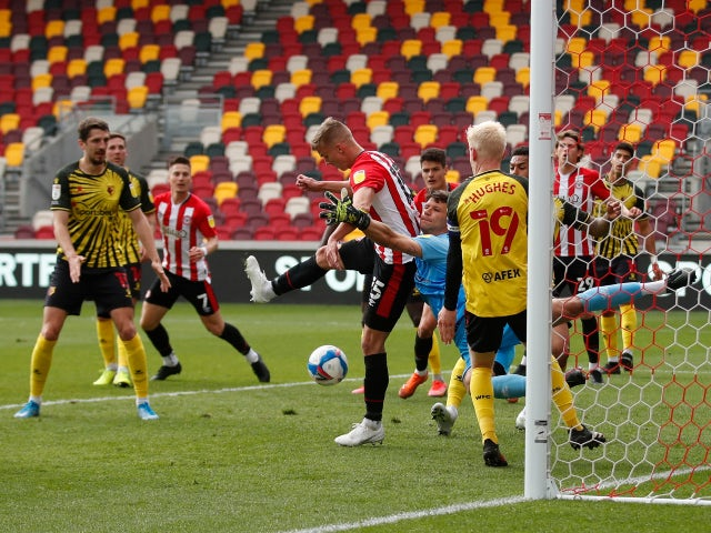 Brentford's Marcus Forss in action with Watford goalkeeper Daniel Bachmann in the Championship on May 1, 2021