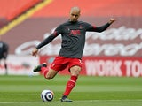 Fabinho warms up for Liverpool in April 2021