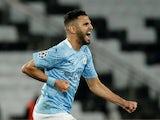 Manchester City's Riyad Mahrez celebrates scoring their second goal on April 29, 2021