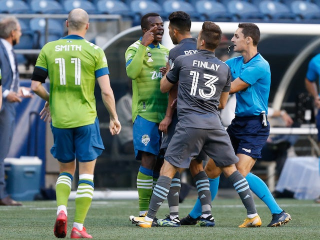 Seattle Sounders FC defender Nouhou (5) and Minnesota United FC midfielder Emanuel Reynoso (10) have words during the first half at Lumen Field on April 17, 2021
