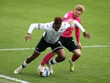 Swansea City's Jamal Lowe in action with Derby County's Kamil Jozwiak in the Championship on May 1, 2021