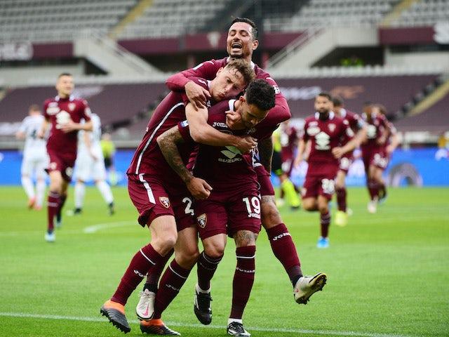 Torino's Antonio Sanabria celebrates scoring their first goal with teammates on April 3, 2021