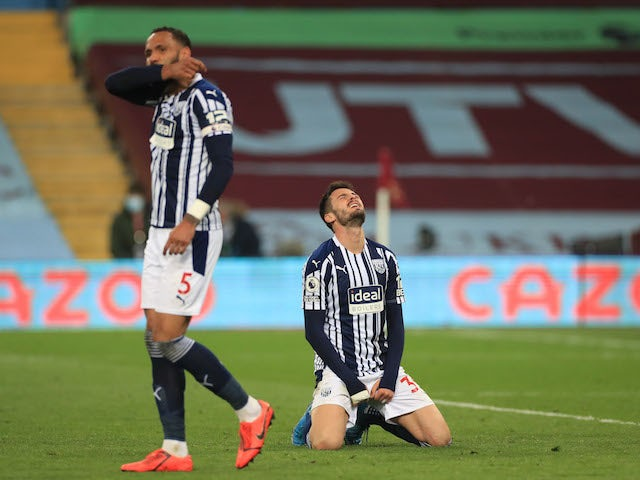 West Bromwich Albion's Okay Yokuslu and Kyle Bartley looks dejected after Aston Villa's second goal on April 25, 2021