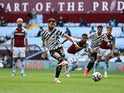 Manchester United's Bruno Fernandes scores their first goal from the penalty spot against Aston Villa in the Premier League on May 9, 2021