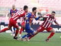 FC Barcelona's Lionel Messi in action with Atletico Madrid's Koke in La Liga on May 8, 2021